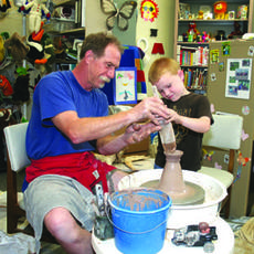 """<div class=""""source""""></div><div class=""""image-desc"""">Albert Bauman, a local artist and storyteller, worked with Ethan Byrd, 4, of Springfield, on a pottery project as part of the Washington County Public Library's summer reading program kickoff.</div><div class=""""buy-pic""""><a href=""""http://web2.lcni5.com/cgi-bin/c2newbuyphoto.cgi?pub=023&orig=LibraryMain.jpg"""" target=""""_new"""">Buy this photo</a></div>"""