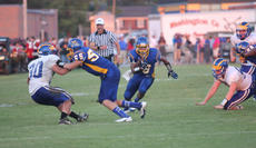 """<div class=""""source"""">Photo by Brandon Mattingly</div><div class=""""image-desc"""">Junior Adam Smith, 55, paves the way for senior tailback Tyler Loving to pick up 18 yards and a first down in the second quarter of Friday's 30-27 loss to Bethlehem.</div><div class=""""buy-pic""""><a href=""""http://web2.lcni5.com/cgi-bin/c2newbuyphoto.cgi?pub=023&orig=Loving.JPG"""" target=""""_new"""">Buy this photo</a></div>"""