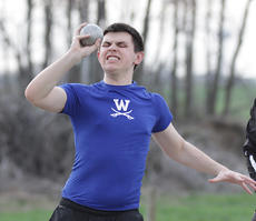 "<div class=""source"">Photo by Jeff Moreland</div><div class=""image-desc"">Sophomore Michael Moreland focuses on his throw with the shot put.</div><div class=""buy-pic""><a href=""/photo_select/14132"">Buy this photo</a></div>"