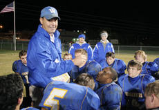 "<div class=""source"">Jeff Moreland</div><div class=""image-desc"">Washington County head football coach Mark Perry gives his team a post-game pep talk after defeating Spencer County for their final home win of the season.</div><div class=""buy-pic""><a href=""/photo_select/1211"">Buy this photo</a></div>"