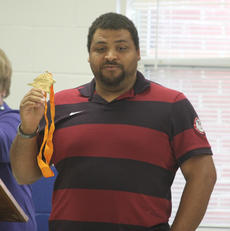 "<div class=""source"">Photo by Brandon Mattingly</div><div class=""image-desc"">Reese Hoffa showed off his world indoor gold medal at St. Dominic last Wednesday.</div><div class=""buy-pic""><a href=""/photo_select/13115"">Buy this photo</a></div>"