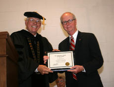 """<div class=""""source"""">Courtesy of SCC</div><div class=""""image-desc"""">Hamilton Simms, right, accepted the Veritas Award from SCC President William Huston at the commencement on Saturday.</div><div class=""""buy-pic""""><a href=""""/photo_select/3956"""">Buy this photo</a></div>"""