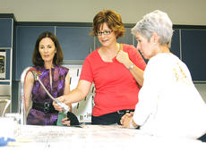 """<div class=""""source"""">Jeff Moreland</div><div class=""""image-desc"""">Dierdre Lyons, left, wife of Alltech founder Dr. Pearse Lyons, gave a tour of the new science lab at Mary Queen of the Holy Rosary in Lexington on Friday. Karen Spaulding, a teacher at St. Dominic School, and Elaine Simms got a closer look at the lab. </div><div class=""""buy-pic""""><a href=""""/photo_select/9523"""">Buy this photo</a></div>"""