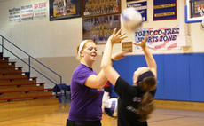 """<div class=""""source"""">Photo by SCC Sports Information</div><div class=""""image-desc"""">St. Catharine junior Cat Hall worked with Washington County's Jordan Wheatley during last week's volleyball camp at Washington County High School.</div><div class=""""buy-pic""""></div>"""