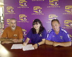 """<div class=""""source"""">Photo by SCC Sports Information</div><div class=""""image-desc"""">Emily Zubricky signed with the Patriots as her dad Rudy, left, and SCC coach Larry Luvisi look on.</div><div class=""""buy-pic""""></div>"""