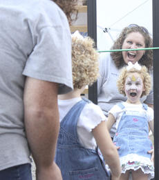 "<div class=""source"">Photo by Brandon Mattingly</div><div class=""image-desc"">Aubrey Hammes, 2, was excited to see the results of her face painting in the mirror at Saturday's Kentucky Crossroads Harvest Festival.</div><div class=""buy-pic""><a href=""/photo_select/15100"">Buy this photo</a></div>"