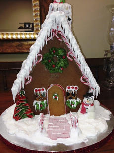 """<div class=""""source"""">Photo submitted</div><div class=""""image-desc"""">A unique homemade and totally edible gingerbread house made by Mary Lou Robertson in honor of Bubba Robertson, long-time rotarian and former club president.This item brought over $150 at auction. </div><div class=""""buy-pic""""></div>"""
