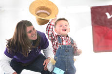"""<div class=""""source"""">Brandon Mattingly</div><div class=""""image-desc"""">Gabriel Thompson, 2, tips his hat to the crowd before taking home a second-place prize. His mother, Joy Thompson, stood beside him. </div><div class=""""buy-pic""""><a href=""""http://web2.lcni5.com/cgi-bin/c2newbuyphoto.cgi?pub=023&orig=baby%2Bhat%2BII.jpg"""" target=""""_new"""">Buy this photo</a></div>"""