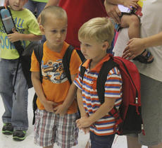 "<div class=""source"">Sun File Photo</div><div class=""image-desc"">Thorin Traffas (left) and Reece Draper prepare for their first day of kindergarten at North Washington School.</div><div class=""buy-pic""><a href=""/photo_select/15600"">Buy this photo</a></div>"