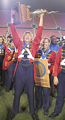 "<div class=""source"">Jeff Moreland</div><div class=""image-desc"">Michael Cook, one of three seniors in the Washington County High School Band, held the trophy high above his head in celebration after the Commanders were named 2008 state champions at Saturday night's Kentucky Music Educator's Association State Marching </div><div class=""buy-pic""><a href=""http://web2.lcni5.com/cgi-bin/c2newbuyphoto.cgi?pub=023&orig=band-a.jpg"" target=""_new"">Buy this photo</a></div>"