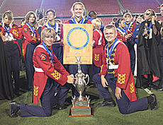 "<div class=""source"">Jeff Moreland</div><div class=""image-desc"">The band's three senior members posed with the championship trophy. They are, from left, Michael Cook, Kristen Harrod and Ryan Price.	</div><div class=""buy-pic""><a href=""http://web2.lcni5.com/cgi-bin/c2newbuyphoto.cgi?pub=023&orig=band-b.jpg"" target=""_new"">Buy this photo</a></div>"