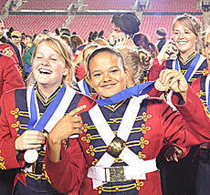 "<div class=""source"">Jeff Moreland</div><div class=""image-desc"">Moriah Hourigan showed off her state championship medal Saturday night at Papa John's Stadium. Band mate Shelby McBride, left, was all smiles, while Ellen Goatley, right, took time to make a phone call and spread the news of Washington County's win.</div><div class=""buy-pic""><a href=""http://web2.lcni5.com/cgi-bin/c2newbuyphoto.cgi?pub=023&orig=band-c.jpg"" target=""_new"">Buy this photo</a></div>"