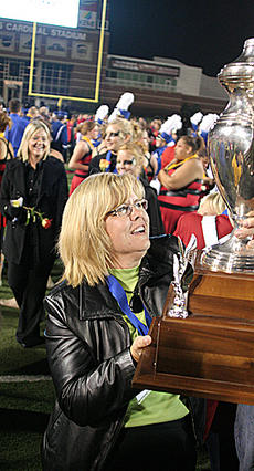 "<div class=""source"">Jeff Moreland</div><div class=""image-desc"">Band director Debbie Harrod looks at the trophy she has sought for the past 26 years of her music career. </div><div class=""buy-pic""><a href=""http://web2.lcni5.com/cgi-bin/c2newbuyphoto.cgi?pub=023&orig=band-e.jpg"" target=""_new"">Buy this photo</a></div>"