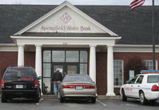 "<div class=""source"">Jeff Moreland</div><div class=""image-desc"">Unaware of the events that took place earlier, potential customers continued to arrive at the Springfield State Bank branch location at 1060 Bardstown Road following a Friday afternoon robbery.</div><div class=""buy-pic""><a href=""/photo_select/3587"">Buy this photo</a></div>"