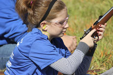 """<div class=""""source"""">Photo submitted</div><div class=""""image-desc"""">Elise Barry prepared her rifle at a shoot this past summer.</div><div class=""""buy-pic""""></div>"""