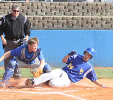 "<div class=""source"">Jeff Moreland</div><div class=""image-desc"">Tyler Coulter slid safely into home as Washington County beat Bethlehem 8-0 Thursday.</div><div class=""buy-pic""><a href=""/photo_select/8525"">Buy this photo</a></div>"
