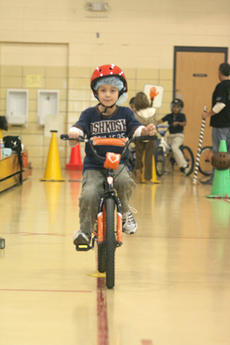"""<div class=""""source"""">Jimmie Earls</div><div class=""""image-desc"""">WCES student Garrett Settles takes a turn around the bicycle safety course in the school's gym last Tuesday. The course was sponsored by the Washington County Family Resource and Youth Services Center and Louisville's Kosair Children's Hospital.</div><div class=""""buy-pic""""><a href=""""/photo_select/4155"""">Buy this photo</a></div>"""