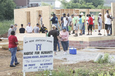 """<div class=""""source"""">Randy Patrick/Landmark News Service</div><div class=""""image-desc"""">Above, a large number of Habitat for Humanity volunteers took part in building Kimberly Phillips' house, shown here, while next door, other volunteers worked on Sharon Boling's.</div><div class=""""buy-pic""""><a href=""""/photo_select/16779"""">Buy this photo</a></div>"""