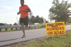 "<div class=""source"">Photo by John Overby</div><div class=""image-desc"">Bourbon Chase runners cut through Washington County late last week as the annual race got underway.</div><div class=""buy-pic""><a href=""http://web2.lcni5.com/cgi-bin/c2newbuyphoto.cgi?pub=023&orig=caution.jpg"" target=""_new"">Buy this photo</a></div>"