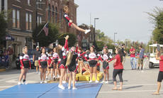 "<div class=""source"">Photo by Brandon Mattingly</div><div class=""image-desc"">Cheerleaders put on a show for bystanders on Main Street on Saturday morning.</div><div class=""buy-pic""><a href=""/photo_select/15106"">Buy this photo</a></div>"