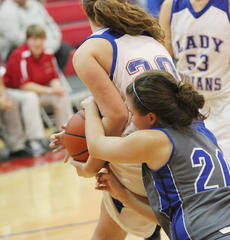 """<div class=""""source"""">Photo by John Overby</div><div class=""""image-desc"""">Senior C.J. (Courtney) Jones tries to rip a rebound away from a Lady Indian in last Saturday's matchup with Adair. </div><div class=""""buy-pic""""><a href=""""/photo_select/15763"""">Buy this photo</a></div>"""