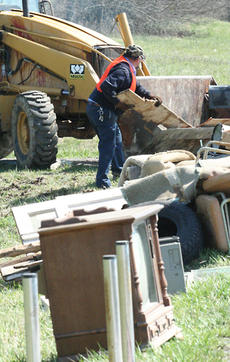 """<div class=""""source"""">Jeff Moreland</div><div class=""""image-desc"""">County workers were busy picking up items left by residents for the annual county-wide clean-up last spring. The clean-up event could be eliminated this year if magistrates vote to do so at a Feb. 9 court meeting.</div><div class=""""buy-pic""""><a href=""""/photo_select/4810"""">Buy this photo</a></div>"""