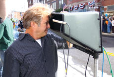 """<div class=""""source"""">Jeff Moreland</div><div class=""""image-desc"""">Jerry Pope of Two Popes Production Company takes a look at a scene of the commercial filmed in downtown Springfield Sunday.</div><div class=""""buy-pic""""><a href=""""/photo_select/3898"""">Buy this photo</a></div>"""