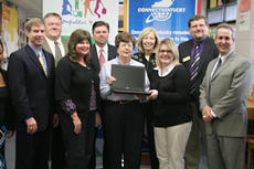 """<div class=""""source"""">Jeff Moreland</div><div class=""""image-desc"""">Billy Ann Riley holds a computer which will be used at the Mackville Community Center. The computer was donated as part of the Computers 4 Kids Program through ConnectKentucky, and will benefit students as well as adults at the center. Pictured are Sen. D</div><div class=""""buy-pic""""><a href=""""/photo_select/6289"""">Buy this photo</a></div>"""