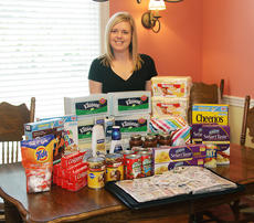 "<div class=""source"">Jeff Moreland</div><div class=""image-desc"">Amy Willis uses coupons on almost every purchase she makes. She said all of the items pictured on her dining room table were purchased at a very reduced price, if not free, with coupons.</div><div class=""buy-pic""><a href=""/photo_select/9460"">Buy this photo</a></div>"