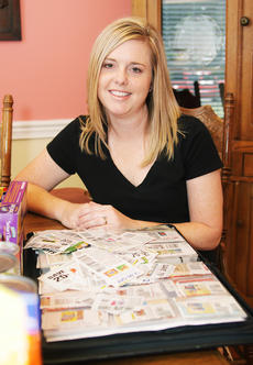 "<div class=""source"">Jeff Moreland</div><div class=""image-desc"">Amy Willis keeps a large binder of coupons, and she takes it with her when she shops for groceries.</div><div class=""buy-pic""><a href=""/photo_select/9461"">Buy this photo</a></div>"