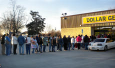"<div class=""source"">Photo submitted</div><div class=""image-desc"">Patrons lined up in anticipation of the grand opening of Dollar General in downtown Willisburg on Saturday morning. </div><div class=""buy-pic""></div>"