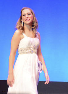 "<div class=""source"">Photo by Chris Zollner</div><div class=""image-desc"">Amanda Cox took the stage during her top-10 finish at the 2014 Kentucky Distinguished Young Woman competition last weekend.</div><div class=""buy-pic""></div>"