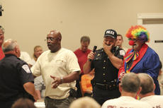 "<div class=""source"">Photo by Brandon Mattingly</div><div class=""image-desc"">Springfield Police Chief Jim Smith couldn't contain his laughter as Springfield Councilmember John ""Willie"" Ellery approached Ofc. Charlie Osbourn during a skit prior to Saturday's award ceremony. Ellery confiscated miniature bottles of Jim Beam from the officers that had been planted by Relapse the Clown. The Springfield Police Department received a $1,000 donation for their part in making the Jim Beam BBQ Classic possible. The event just completed its fifth year being hosted in Springfield.</div><div class=""buy-pic""><a href=""/photo_select/15104"">Buy this photo</a></div>"