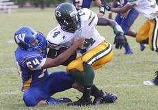 "<div class=""source"">Brandon Mattingly</div><div class=""image-desc"">Seniors Tylyn Byas (No. 10) and Morgan Churchill (No. 8) brought down a Green County ball-carrier in Sunday's 48-0 loss in the Heart of Kentucky Pigskin Classic.</div><div class=""buy-pic""><a href=""/photo_select/14885"">Buy this photo</a></div>"