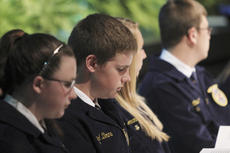 "<div class=""source"">Photo by John Overby</div><div class=""image-desc"">Members look on as fellow FFA'ers are recognized.</div><div class=""buy-pic""><a href=""/photo_select/16392"">Buy this photo</a></div>"