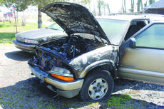 """<div class=""""source"""">Photo by Brandon Mattingly</div><div class=""""image-desc"""">The Chevy Blazer sits in the driveway after the fire is put out. </div><div class=""""buy-pic""""><a href=""""/photo_select/14109"""">Buy this photo</a></div>"""