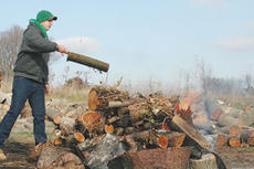 "<div class=""source"">Jimmie Earls</div><div class=""image-desc"">Jonathan Giorgio of Bowling Green throws a log onto the fire at Isaiah House used to burn up soft wood.</div><div class=""buy-pic""><a href=""/photo_select/1778"">Buy this photo</a></div>"