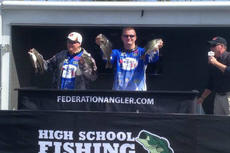 """<div class=""""source"""">Photo submitted</div><div class=""""image-desc"""">After a long season, WC's bass fishing team was able to send two groups of fishermen to the KHSAA state tournament. Above, Michael Sandusky (right) and Michael Shelton show off their catches at the regional tournament that helped them capture first place.</div><div class=""""buy-pic""""></div>"""