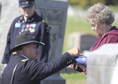 "<div class=""source"">Sun File Photo</div><div class=""image-desc"">Col. Tracy Lucas of the Nelson Honor Guard presented an American flag to a descendant of William Frank Hall, a Civil War veteran who recently received a funeral of the era at Bethlehem Baptist Church.</div><div class=""buy-pic""><a href=""/photo_select/15602"">Buy this photo</a></div>"