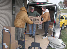"<div class=""source"">Diane McDaniel</div><div class=""image-desc"">Jim Smith, center, and Kenny Monroe hand a box of eggs to  Gary Bell as they unload the trailer of Angel Food for pickup at  Temple Baptist Church.</div><div class=""buy-pic""><a href=""/photo_select/1789"">Buy this photo</a></div>"