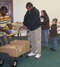 "<div class=""source"">Diane McDaniel</div><div class=""image-desc"">Angel Food orders are filled quickly with the assistance of the church member volunteers.</div><div class=""buy-pic""><a href=""/photo_select/1788"">Buy this photo</a></div>"