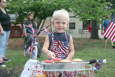 """<div class=""""source"""">Jimmie Earls</div><div class=""""image-desc"""">Dalton Carney, age 4, poses with his barbeque grill-enhanced bicycle.  Dalton placed first in the best decorated bike contest during Springfield's Independence Day celebration.</div><div class=""""buy-pic""""><a href=""""http://web2.lcni5.com/cgi-bin/c2newbuyphoto.cgi?pub=023&orig=fourth08-web4.jpg"""" target=""""_new"""">Buy this photo</a></div>"""