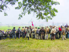 """<div class=""""source""""></div><div class=""""image-desc"""">More than 13,000 people took part in the re-enactment of the Battle of Gettysburg in Pennsylvania on July 4, 2008. Among them was Lee Lewis of Willisburg.</div><div class=""""buy-pic""""><a href=""""/photo_select/99"""">Buy this photo</a></div>"""