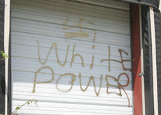 """<div class=""""source"""">Jeff Moreland</div><div class=""""image-desc"""">Graffiti was painted on numerous buildings and other property by a group of four juveniles, and police say more charges are expected against others in the case.</div><div class=""""buy-pic""""><a href=""""/photo_select/159"""">Buy this photo</a></div>"""