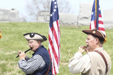 """<div class=""""source"""">Photo by Brandon Mattingly</div><div class=""""image-desc"""">Color guard members provide the music of the era to accompany the memorial.</div><div class=""""buy-pic""""><a href=""""/photo_select/16277"""">Buy this photo</a></div>"""