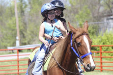 """<div class=""""source"""">Photo by John Overby</div><div class=""""image-desc"""">Guests were treated to local food, live music, games and other activities at the inaugural Green Festival sponsored by the New Pioneers for a Sustainable Future.  Above, Andrea Cooksey and Emily Sester ride the ponies at this past weekend's event.</div><div class=""""buy-pic""""><a href=""""/photo_select/16251"""">Buy this photo</a></div>"""