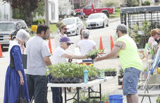 """<div class=""""source"""">Photo by Brandon Mattingly</div><div class=""""image-desc"""">Visitors make a purchase at this past weekend's Green Festival, which was hosted by the New Pioneers for a Sustainable Future.</div><div class=""""buy-pic""""><a href=""""/photo_select/16254"""">Buy this photo</a></div>"""