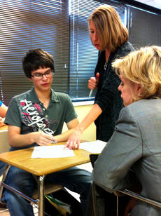 "<div class=""source"">Jesse Osbourne</div><div class=""image-desc"">John Martinez, left, and Danielle Burke, center, discussed an assignment while Dr. Mariana Haynes, right, observed during class at Washington County High School on Wednesday of last week. Haynes, with the Alliance for Excellent Education in Washington, D.C., visited two school districts last week to observe classes.  </div><div class=""buy-pic""><a href=""/photo_select/10108"">Buy this photo</a></div>"
