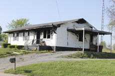 """<div class=""""source"""">Photo by Brandon Mattingly</div><div class=""""image-desc"""">Ashley Simms and her six children escaped their home at Rosary Heights last week without injury, but the fire claimed relatively all of their belongings.</div><div class=""""buy-pic""""><a href=""""http://web2.lcni5.com/cgi-bin/c2newbuyphoto.cgi?pub=023&orig=house_fire.jpg"""" target=""""_new"""">Buy this photo</a></div>"""