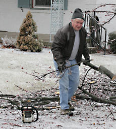"""<div class=""""source"""">Jeff Moreland</div><div class=""""image-desc"""">Benny Wheatley of Springfield was busy cutting up a fallen tree and removing the pieces after Tuesday night and Wednesday morning's ice storm brought the tree down in his driveway.</div><div class=""""buy-pic""""><a href=""""/photo_select/2324"""">Buy this photo</a></div>"""